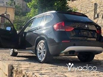 BMW in Bekaata Ashkout - BMW X1 2012 black on black panoramic AWD 2.0Turbo
