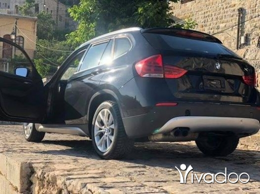 BMW in Beirut City - BMW X1 2012 black on black panoramic AWD 2.0Turbo