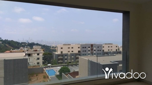 Apartments in Fanar - A 190 m2 apartment with a pool having an open mountain/sea view for sale in Fanar