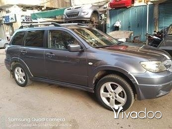 Mitsubishi in Tripoli - لبيع ميتسوبيشي اوتلاندر موديل 2005 مفول ولا رنة ما بدو شي استخدام سيدة مسجلة شاشة فرش جلد فتحة