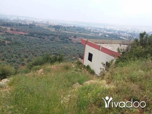 شقق في سير ضنيه - عقار كامل للبيع ارض مع بيت مطل رائع