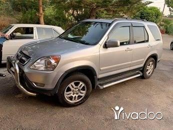 Honda in Tripoli - سي ار في موديل ٢٠٠٤ EX فورويل مكيف شغال دواليب جداد ما عليه مكنيك مفول من كلشي الب جلد اسود