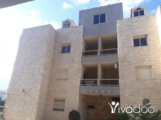 Apartments in Bouar - شقة جديدة مميزة في اطلالتها للبيع في منطقة البوار تابعة لمنطقة بوار العقارية.