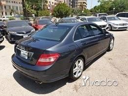 Mazda in Tripoli - 2011 mercedes C300. Grey on black.
