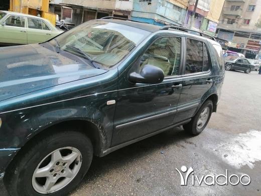 Mercedes-Benz in Tripoli - للبيع مرسيديس mlموديل 98 مفول مكيف تلج ماشي 140 الف ولا رنة جيب كتير ناعم بعدو عل كيانو