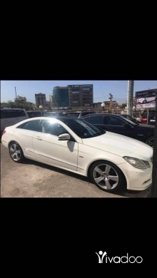 Mercedes-Benz in Baouchriye - Mercedes E 250 2011 white inside basket