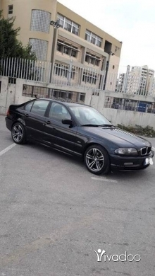 BMW in Tripoli - ٣٢٥ ٢٠٠١ أسود قلب أسود