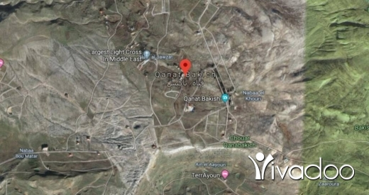 Land in Bekaata Kenaan - A 24000 m2 land having an open mountain view for sale in Qanat Bakish