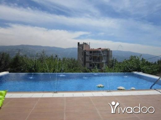 فلل في عجلتون - A 540 m2 duplex villa with a garden on  a 1016 m2 land for sale in Ajaltoun