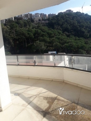 Apartments in Bsalim - A 180 m2 apartment with an open mountain view for sale in Bsalim