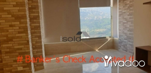 Apartments in Loueizeh - A semi -furnished 145 m2 apartment having an open mountain view for sale in Louayze