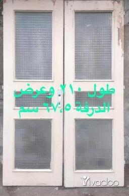 Home & Garden in Beirut City - باب خشب زين ١٠٠٪ درفتين للصالون خشب كتير ثقيل مع الصندوق الدرفة طولها ٢١٠ سم وعرض الدرفة ٦٧،٥ سم