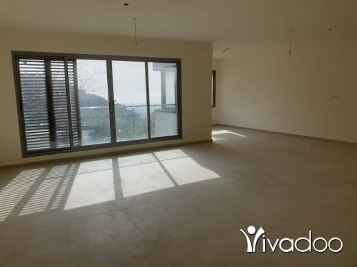 Apartments in Bsous - A decorated 222 m2 apartment having an open mountain/sea view for sale in Bsous