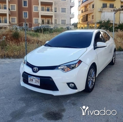 Toyota in Haoush ez Zaraane - Toyota corolla 2014 very clean fully loaded for more info 76/019980 8500$$$