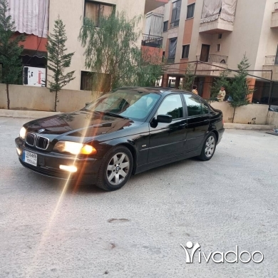 BMW in Haoush ez Zaraane - Bmw new boy 323i mod 2001, aswad alba beige , sayyara khar2a , sport package , info 81890665.