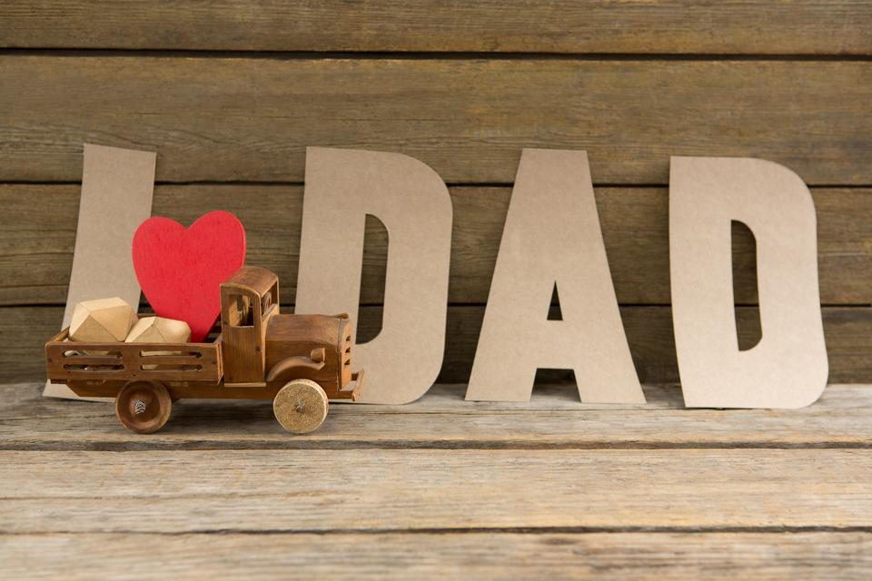 """""""Close up of dad text by heart shape in toy truck"""" stock image"""