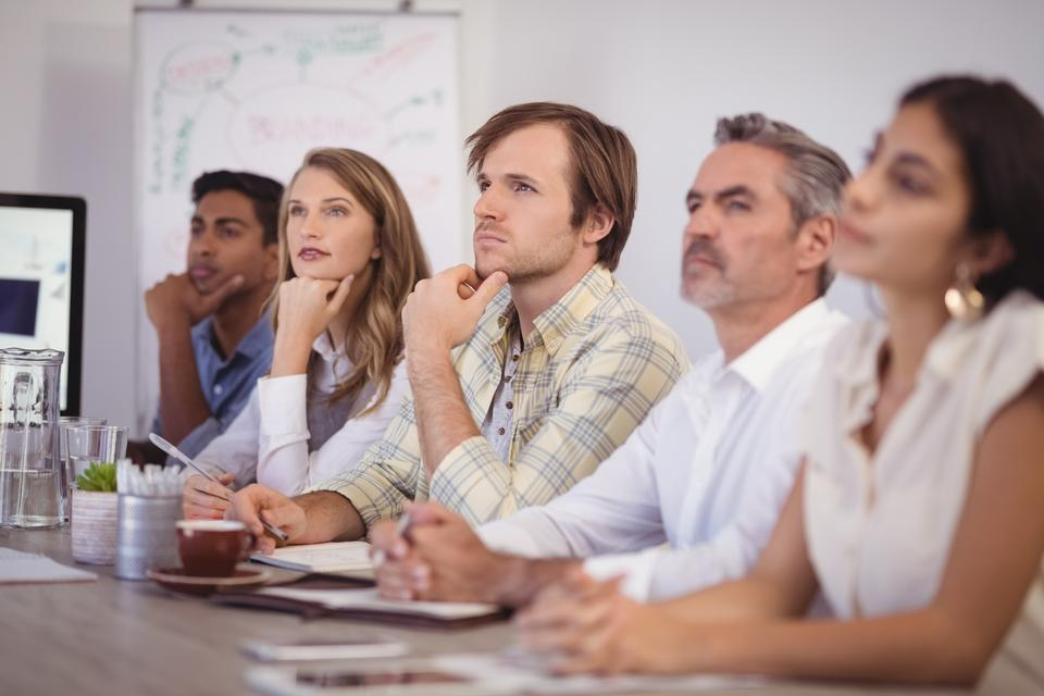 """""""Business people sitting in conference room at office"""" stock image"""