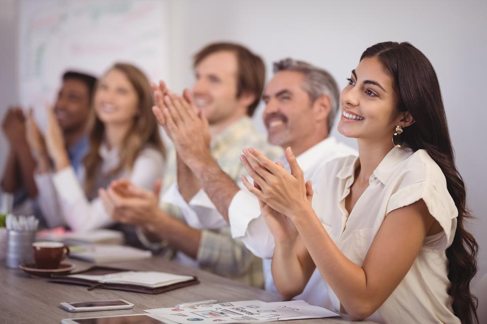 """""""Business people applauding during presentation in office"""" stock image"""