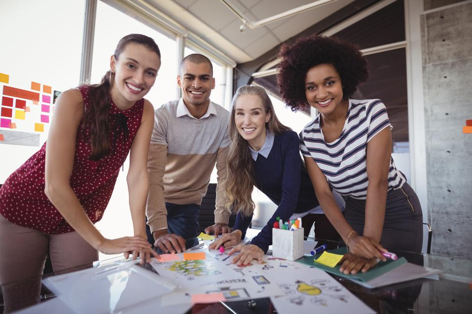 """""""Smiling business people planning in creative office"""" stock image"""