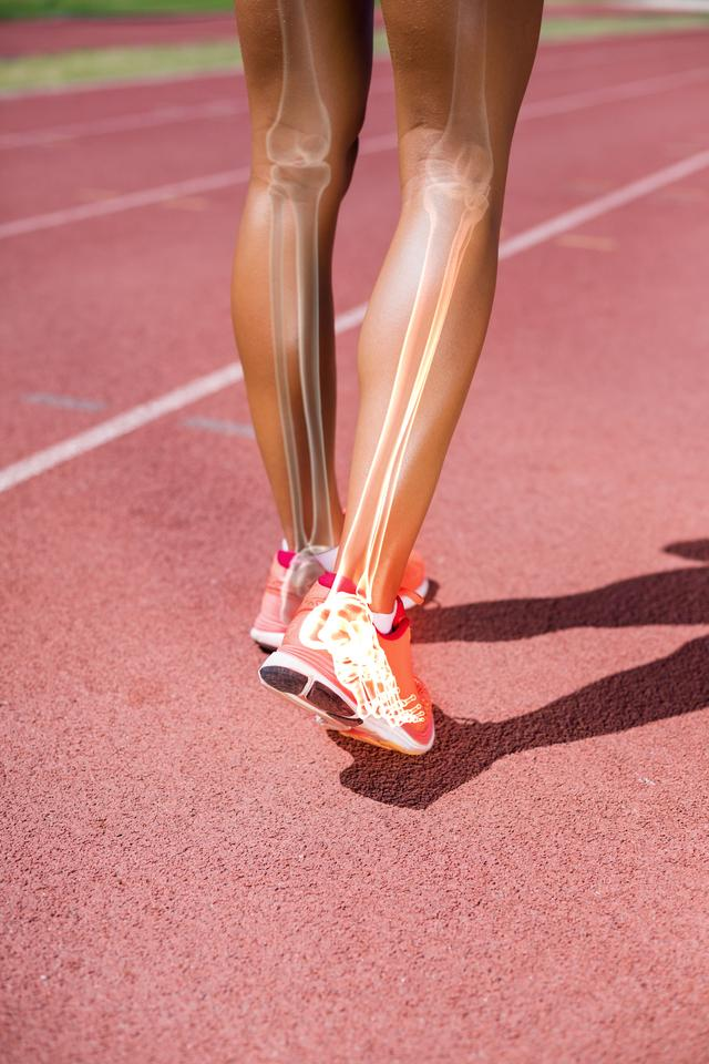 """""""Low section of athlete walking on track"""" stock image"""