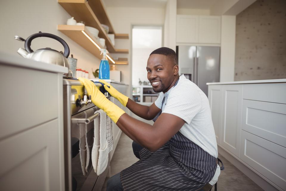"""Portrait of smiling man in kitchen"" stock image"