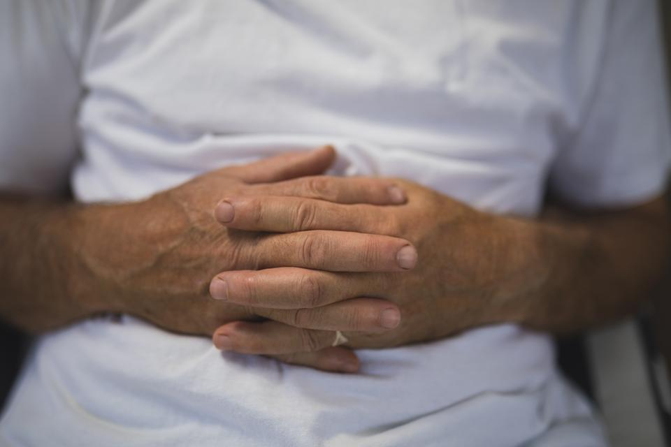 """""""Senior man with hands clasped"""" stock image"""