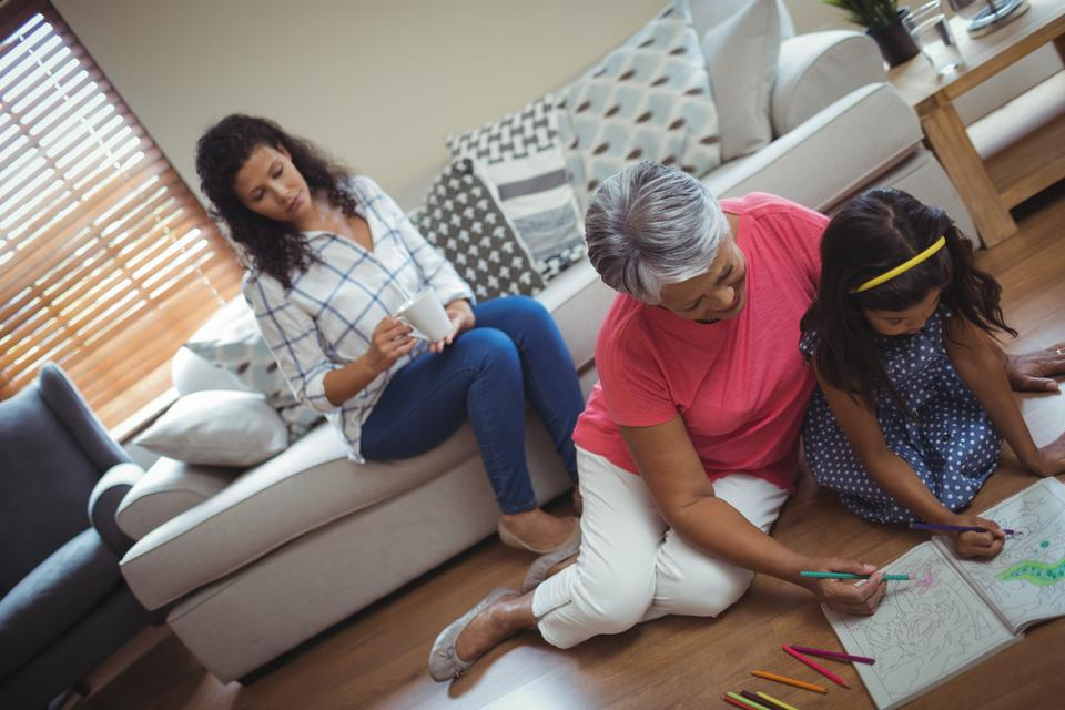 """""""Grandmother and granddaughter coloring book in living"""" stock image"""