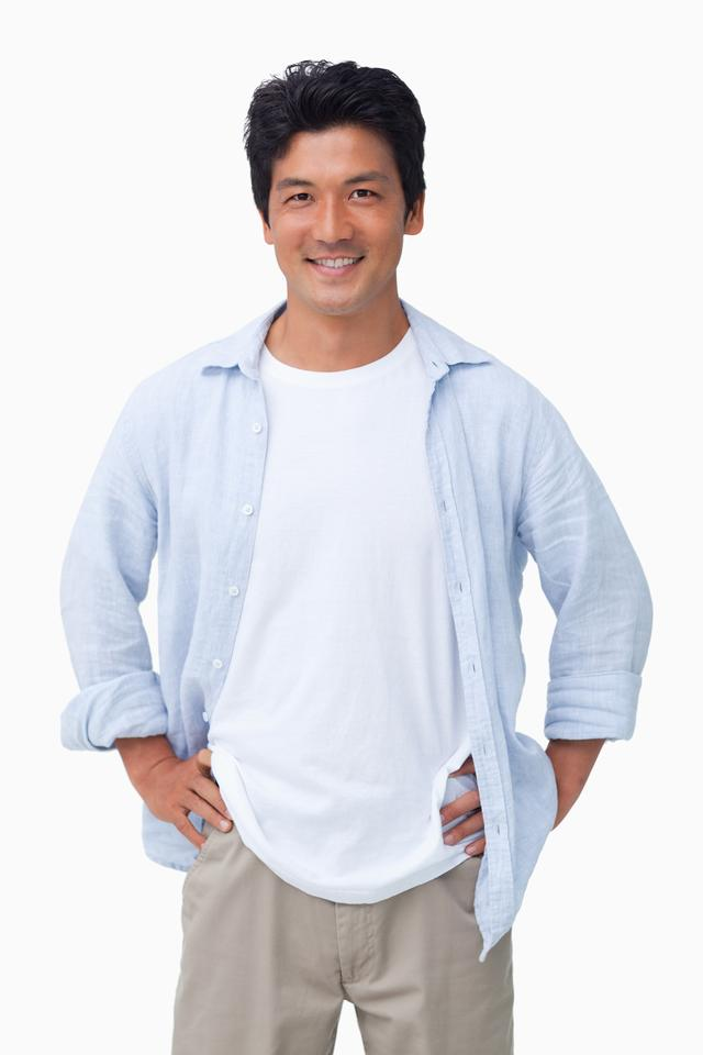 """Smiling male with hands on his hip"" stock image"