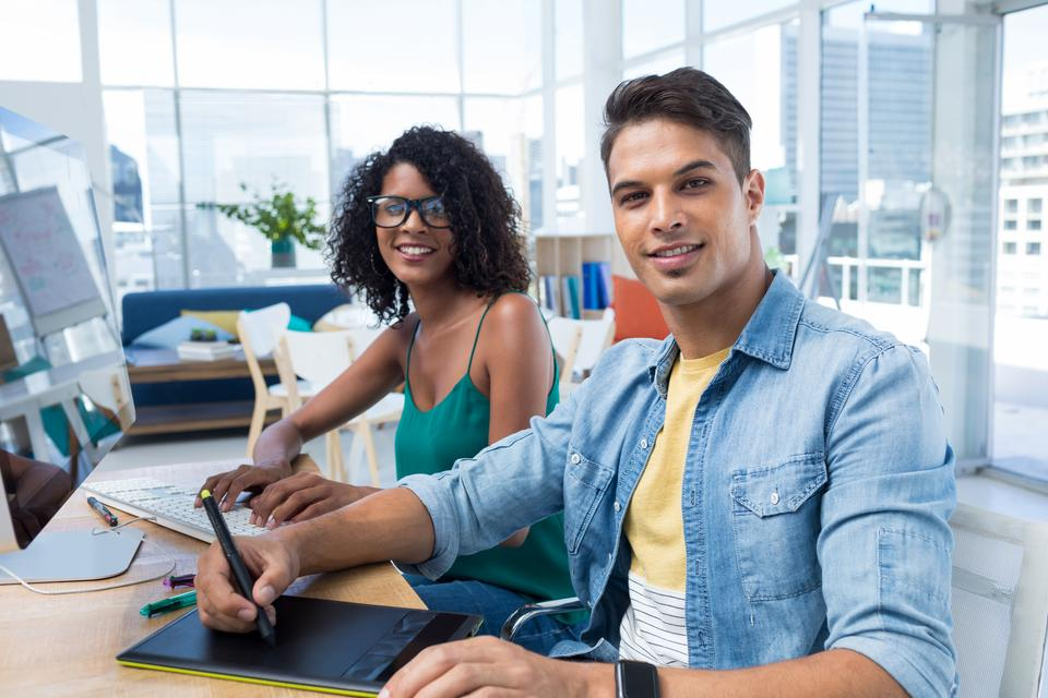 """""""Graphic designers working on computer at desk"""" stock image"""