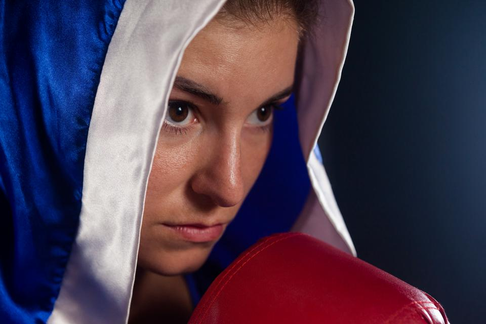 """Determined woman wearing boxing robe"" stock image"