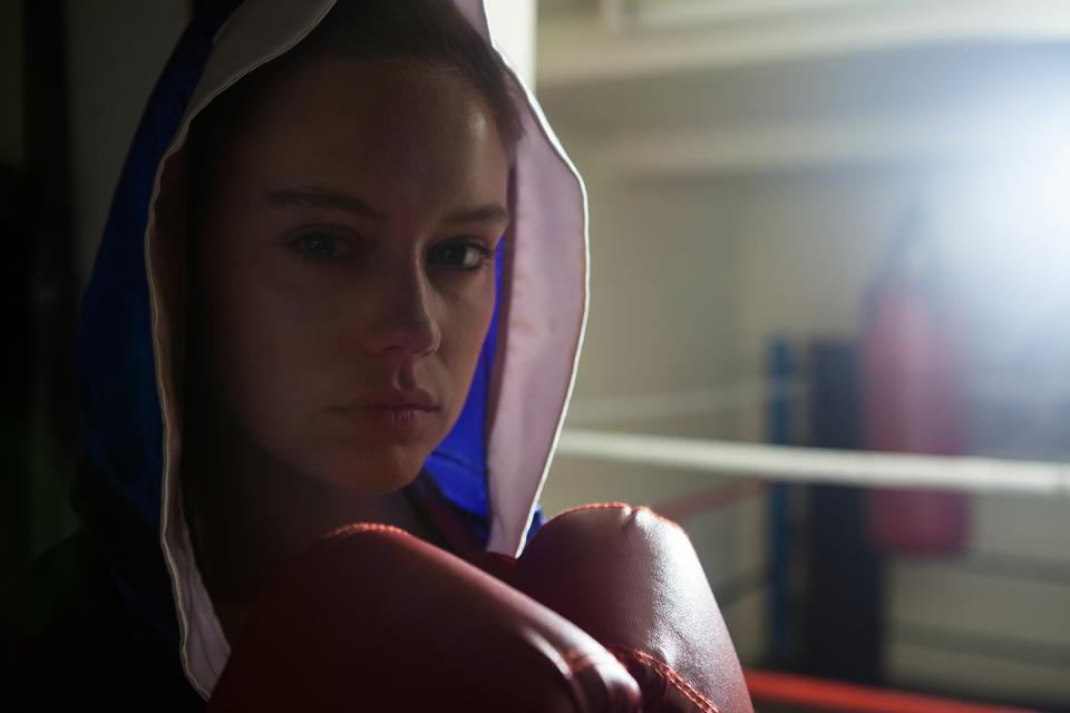 """Woman practicing boxing in fitness studio"" stock image"