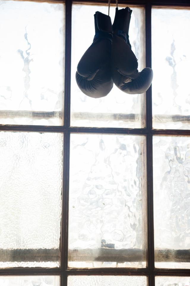 """Pair of boxing gloves hanging on window"" stock image"