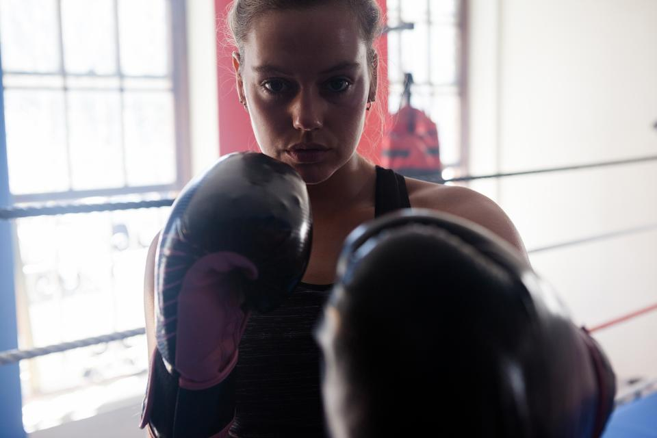 """Portrait of confident woman practicing boxing"" stock image"