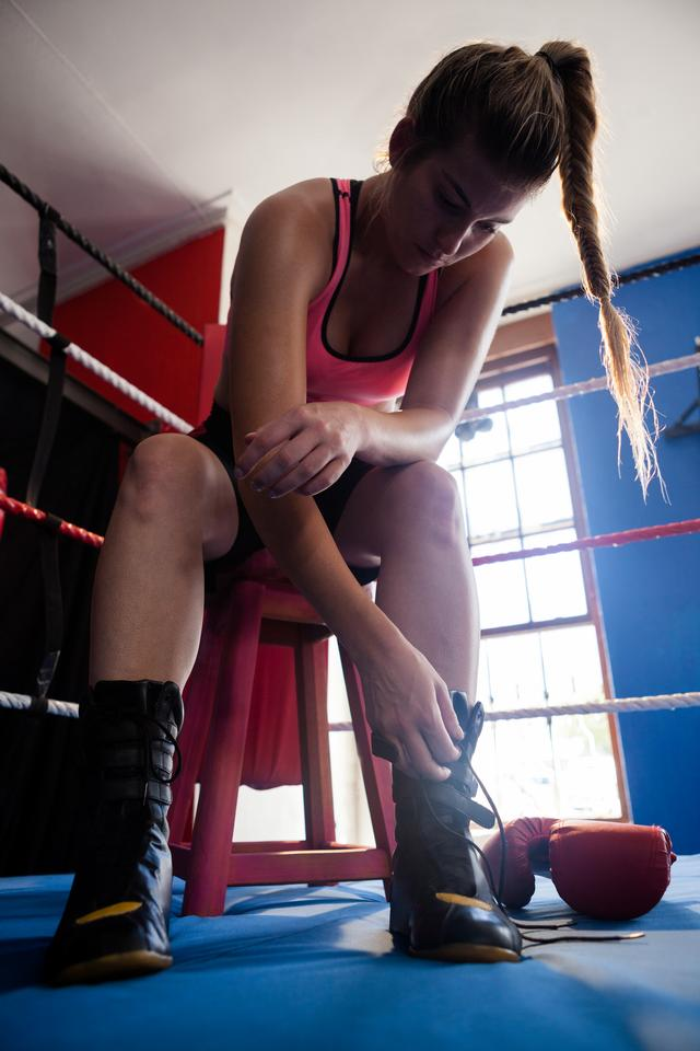 """Woman wearing shoes in boxing ring"" stock image"