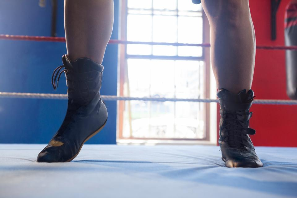 """Low section of woman in boxing ring"" stock image"