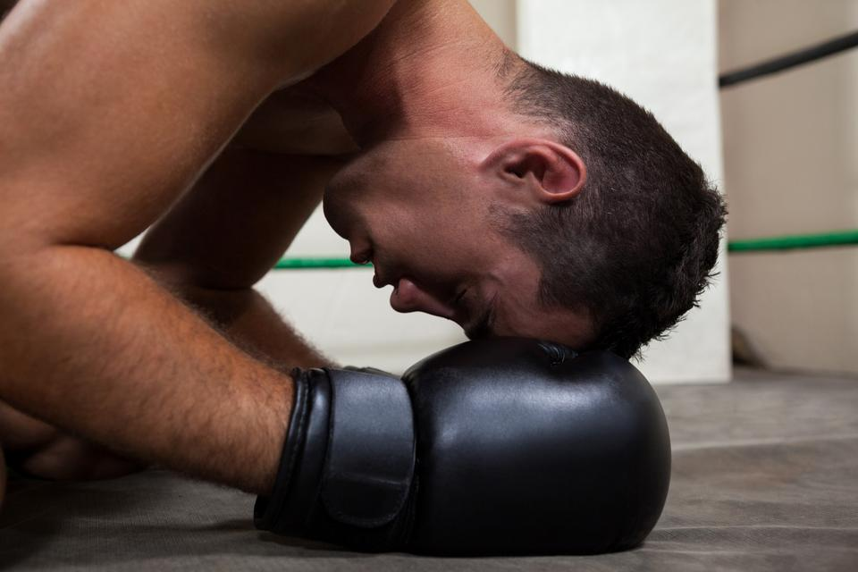 """Boxer relaxing in the boxing ring"" stock image"