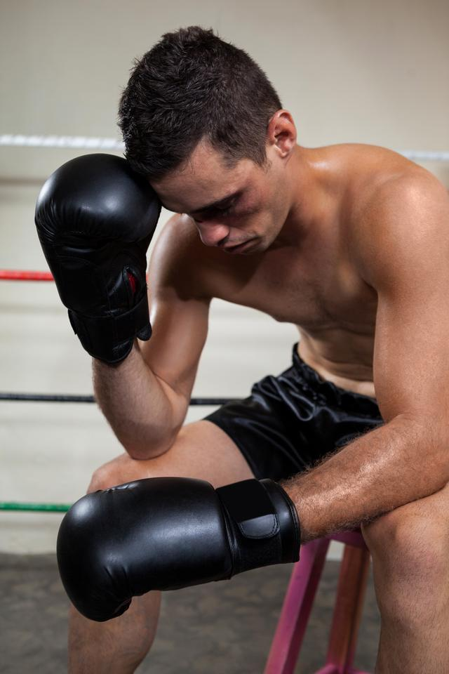 """Wounded boxer relaxing in the boxing ring"" stock image"