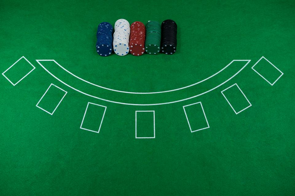 """High angle view of chips on blackjack table"" stock image"