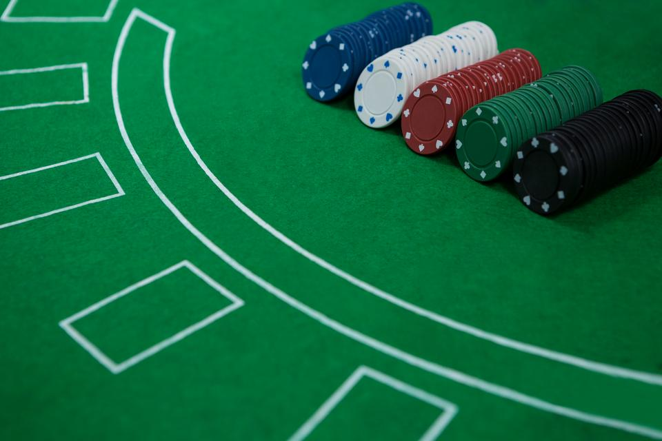 """Close-up of chips on blackjack table"" stock image"