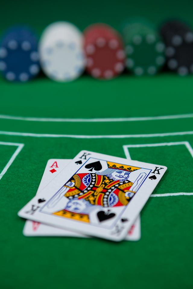 """Close-up of cards and chips on blackjack table"" stock image"