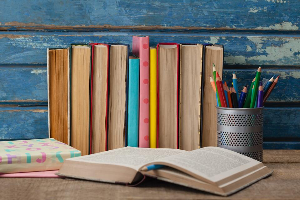 """""""Stack of books, open book and pen holder"""" stock image"""