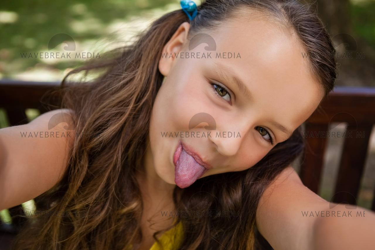 teen sticking tongue out