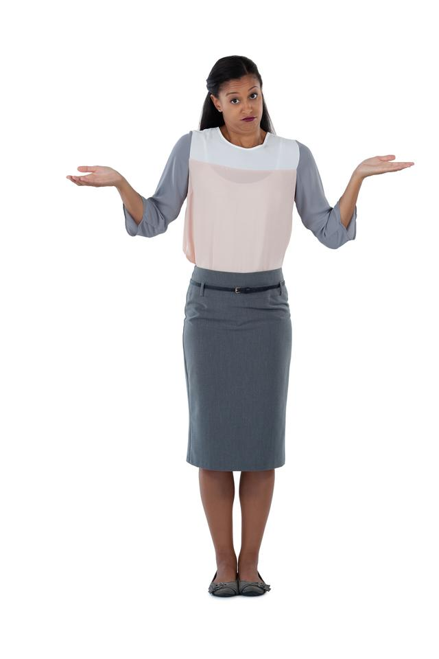 """""""Frowning businesswoman shrugging her shoulders"""" stock image"""