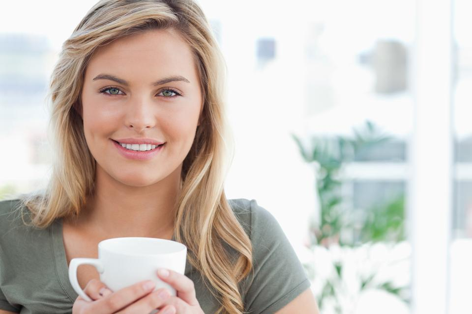 Indian girl holding coffee mug high resolution stock photography and images
