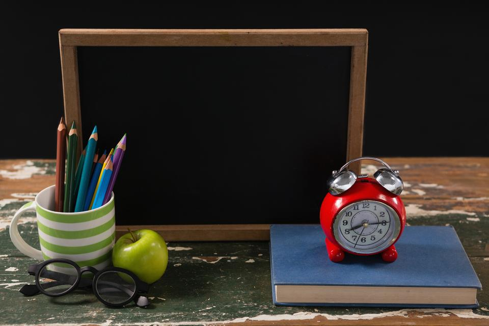 """""""Chalkboard with book, pen holder, apple and spectacles"""" stock image"""