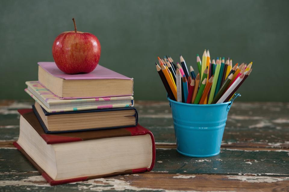 """""""Apple on stack of books with pen holder"""" stock image"""