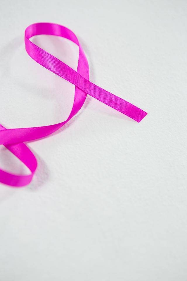 """High angle view of pink ribbon for Breast Cancer"" stock image"