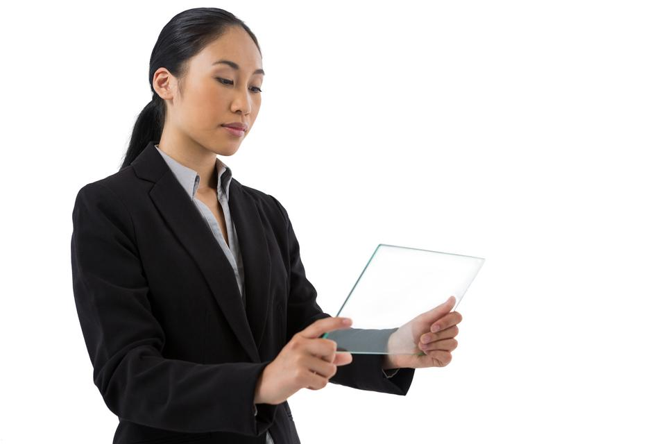 """""""Female executive using a glass digital tablet"""" stock image"""
