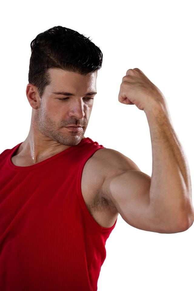 """""""Male thlete flexing muscles"""" stock image"""