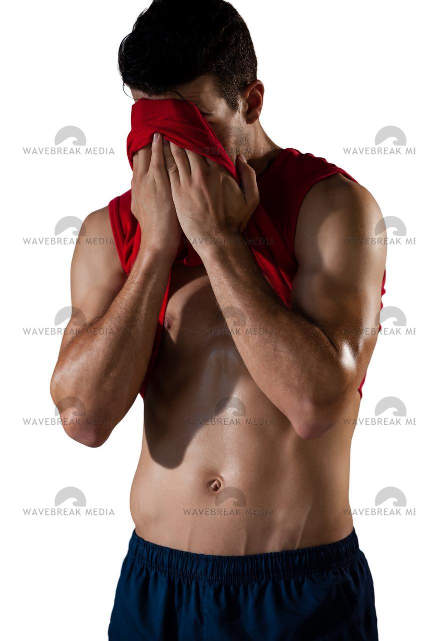 """Sportsman rubbing face with vest"" stock image"